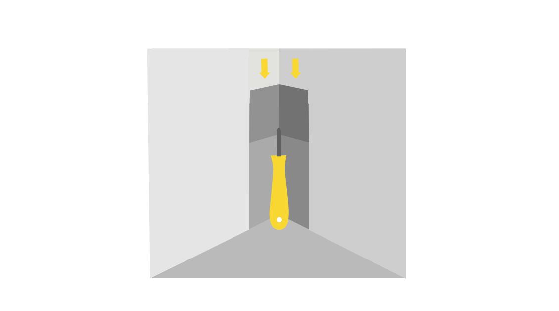 До финишного состояния угол можно довести с помощью углового шпателя
